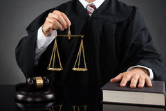 Judge Holding Weight Scale Stock Photos