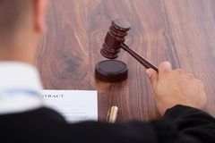 Judge knocking gavel Stock Photo