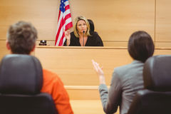 Judge and lawyer discussing the sentence for prisoner Royalty Free Stock Photos