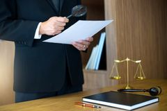 Judge lawyer read paper text by use Magnify glass. Concept law firm Royalty Free Stock Image
