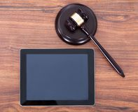 Judge mallet on block by digital tablet royalty free stock images