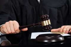 Judge with mallet at desk. Closeup of male judge with mallet at desk Stock Image