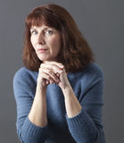 Judge mental concept for dubious 50s woman Stock Image