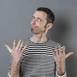 Judge mental concept for suspicious 40s man Stock Images
