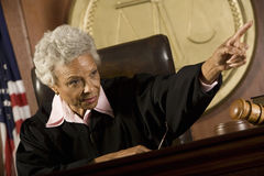 Judge Pointing In Courtroom Stock Photo