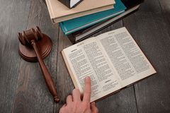 Judge reading book of Exodus. Judge reading the book of Exodus using a finger. Bible, Ten commandments and modern juridical system royalty free stock images