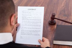 Judge reading contract in courtroom Stock Images