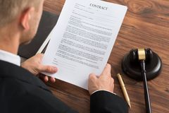 Judge reading contract paper Royalty Free Stock Photo