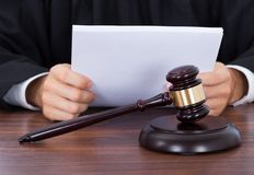 Judge reading documents at desk Royalty Free Stock Photography