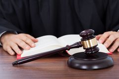 Judge reading law book at desk Royalty Free Stock Photos