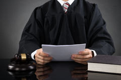 Judge Reading Paper Royalty Free Stock Photography