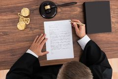 Judge Reading Paper In Courtroom Royalty Free Stock Photos