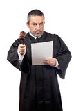 Judge reading a sentence Royalty Free Stock Image
