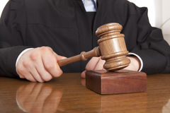Judge. Referee hammer and a man in judicial robes Stock Images