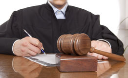 Judge. Referee hammer and a man in judicial robes Stock Photos