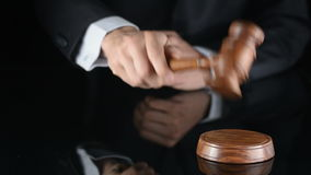 Judge. Referee hammer and a man in judicial robes. Knocking hammer stock video footage