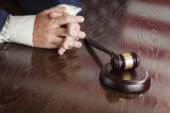 Judge Rests Hands Behind Gavel with American Flag Table Reflecti Royalty Free Stock Photo