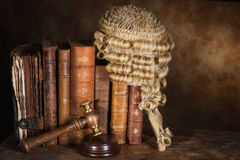 Judge's books. Antique judge's wig hanging on very old books royalty free stock photos