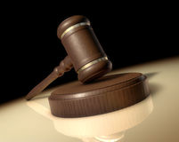 Judge's Gavel. A Judges gavel on a desk in a spotlight Stock Photography