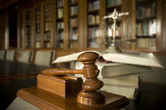 Judges gavel. Symbol of law and justice in the library, law and justice concept, focus on the gavel Stock Images