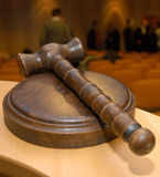 Judge´s gavel. A wooden judge´s gavel court room at the back Royalty Free Stock Photo