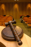 Judge´s gavel. A wooden judge´s gavel court room at the back Stock Images