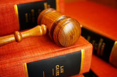 Judge's gavel. Judges gavel on a pile of law books Stock Photo