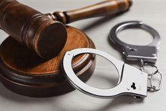 Free Judge`s Gavel And Handcuffs On White Wooden Background. Criminal Law Concept Stock Photography - 159805912