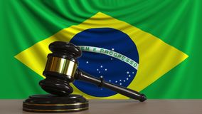 Judge`s gavel and block against the flag of Brazil. Brazilian court conceptual 3D rendering. Judge`s gavel and block against the flag. Court conceptual 3D Royalty Free Stock Photography