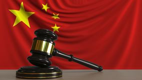 Judge`s gavel and block against the flag of China. Chinese court conceptual 3D rendering. Judge`s gavel and block against the flag. Court conceptual 3D Stock Photo