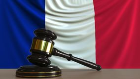 Judge`s gavel and block against the flag of France. French court conceptual 3D rendering. Judge`s gavel and block against the flag. Court conceptual 3D Stock Photo