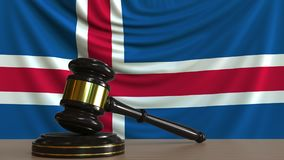 Judge`s gavel and block against the flag of Iceland. Icelandic court conceptual 3D rendering. Judge`s gavel and block against the flag. Court conceptual 3D Royalty Free Stock Photos