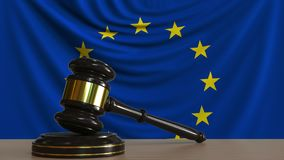 Judge`s gavel and block against the flag of the European Union. Court conceptual 3D rendering. Judge`s gavel and block against the flag. Court conceptual 3D Royalty Free Stock Photo