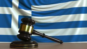 Judge`s gavel and block against the flag of Greece. Greek court conceptual 3D rendering. Judge`s gavel and block against the flag. Court conceptual 3D Stock Photo