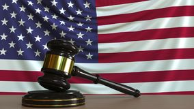 Judge`s gavel and block against the flag of the United States. American court conceptual 3D rendering. Judge`s gavel and block against the flag. Court conceptual Stock Photos