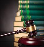 Judge's gavel in front of a pile of law books Royalty Free Stock Photos