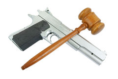 Judge's gavel and gun isolated Royalty Free Stock Images