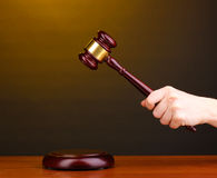 Judge's gavel in hand Royalty Free Stock Images