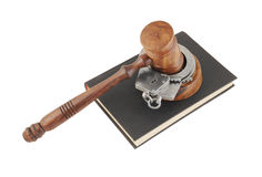 Judge's gavel and handcuffs on black legal book Royalty Free Stock Photo
