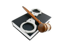 Judge's gavel and handcuffs on book Stock Photos