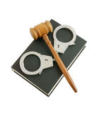 Judge's gavel and handcuffs on book Stock Photo