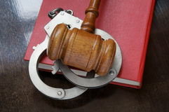Judge's gavel and handcuffs on book Royalty Free Stock Image