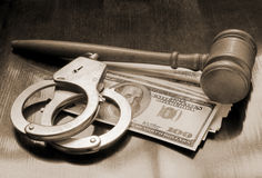 Judge's gavel, handcuffs and money Stock Images