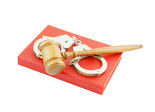 Judge's gavel and handcuffs on red legal book Royalty Free Stock Images