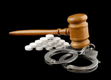 Judge's gavel, handcuffs and tablets Royalty Free Stock Image