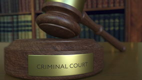 Judge`s gavel hitting the block with CRIMINAL COURT inscription. 3D rendering Stock Image