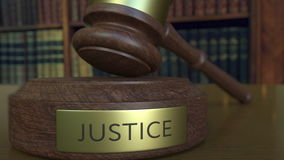 Judge`s gavel hitting the block with JUSTICE inscription. 3D rendering Royalty Free Stock Images