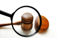 Judge's gavel and magnifying glass Stock Photo