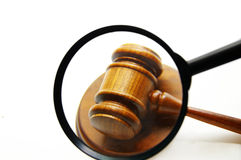 Judge's gavel and magnifying glass royalty free stock photography