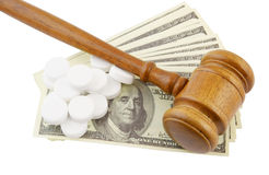 Judge's gavel, money and tablets Stock Image